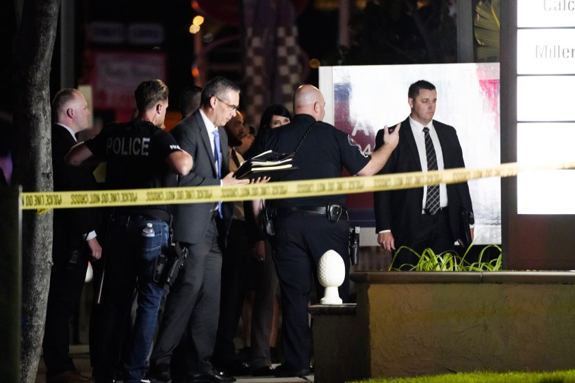 Police respond to the scene of a multiple shooting on March 31 in Orange. In response to recent mass shootings, California lawmakers want to tax guns to pay for anti-violence programs.(Kent Nishimura / Los Angeles Times)