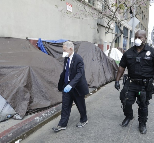 U.S. District Court judge David O. Carter tours skid row with LAPD Officer Deon Joseph on April 3, 2020. (Myung J. Chun / Los Angeles Times)