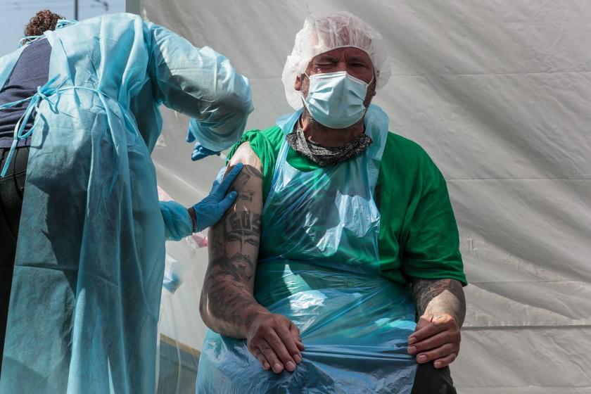 Homeboy employee Joseph Kuresa recieves a shot from Shaun Murry. (Robert Gauthier/Los Angeles Times)