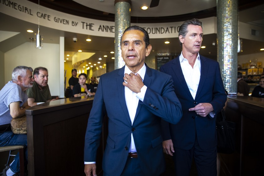 Former Mayor Antonio Villaraigosa and then-Lt. Gov. Gavin Newsom at a June 2018 news conference in front of Homegirl Cafe in Los Angeles.(Los Angeles Times)