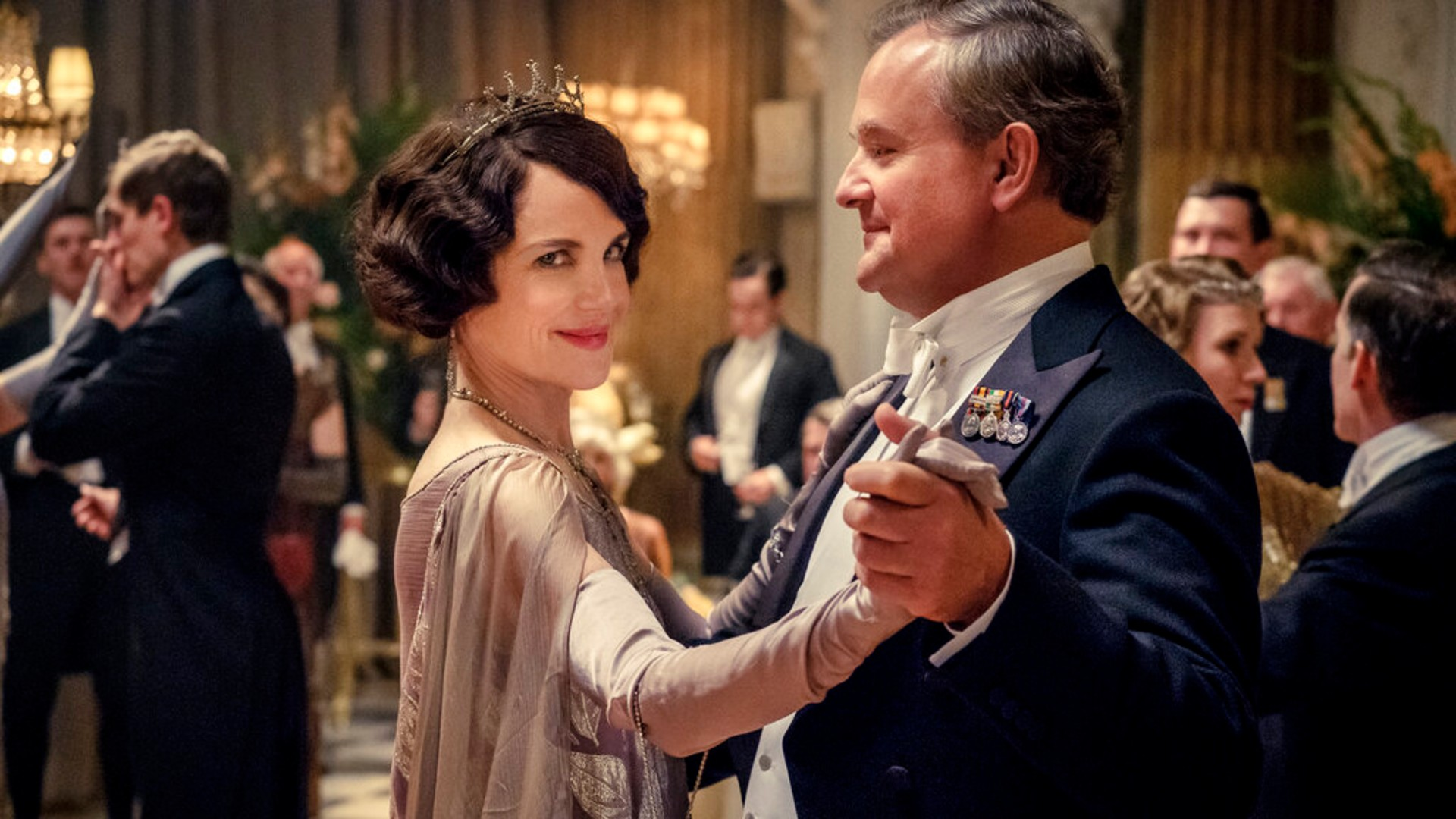 "This image released by Focus Features shows Elizabeth McGovern, left, as Lady Grantham and Hugh Bonneville, as Lord Grantham, in ""Downton Abbey"". (Jaap Buitendijk/Focus Features via AP)"