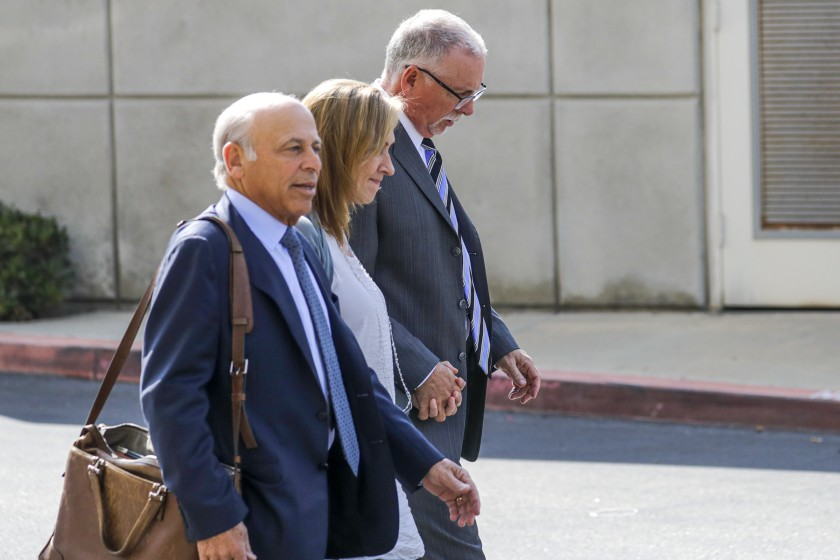 Former UCLA gynecologist Dr. James M. Heaps (right) leaves leaves Airport Superior Court in Los Angeles in 2019. (Irfan Khan / Los Angeles Times)