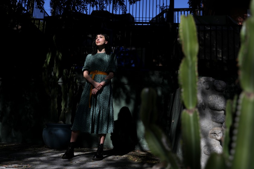 Angela Meriquez Vázquez, 33, was infected with COVID-19 in March 2020. She has long COVID and still suffers from symptoms of the disease.(Gary Coronado / Los Angeles Times)
