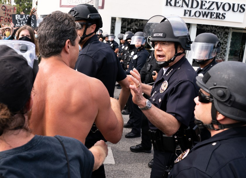 LAPD Chief Michel Moore speaks with protesters in the Fairfax district on May 30.(Kent Nishimura / Los Angeles Times)