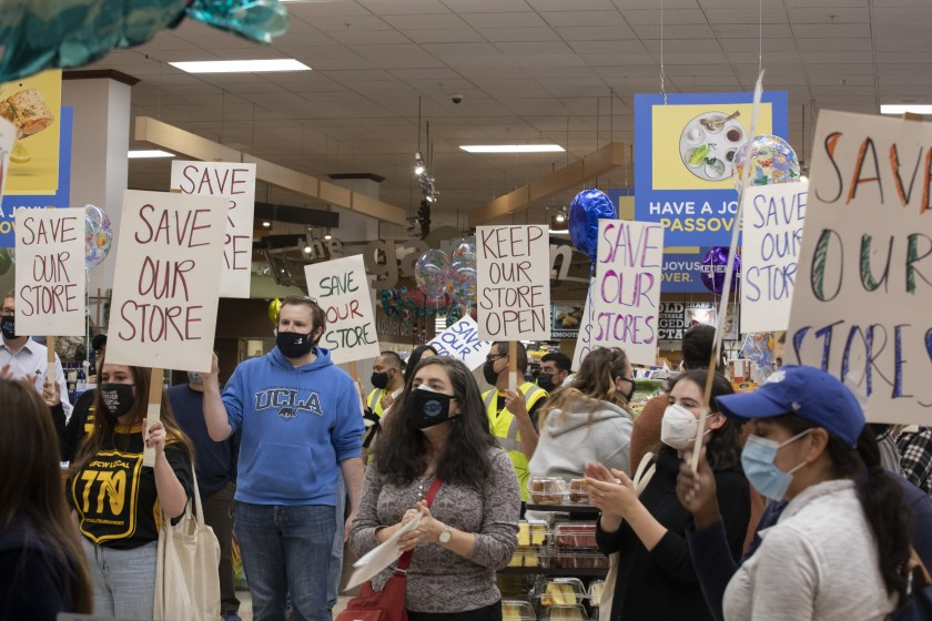Demonstrators take their message inside the Ralphs supermarket in L.A.'s Pico-Robertson neighborhood to protest its planned closure.(Myung J. Chun / Los Angeles Times)