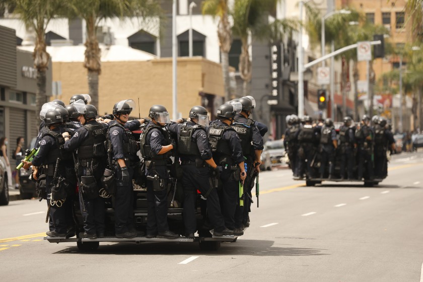 LAPD officers respond to a protest in Hollywood in early June 2020. (Al Seib / Los Angeles Times)