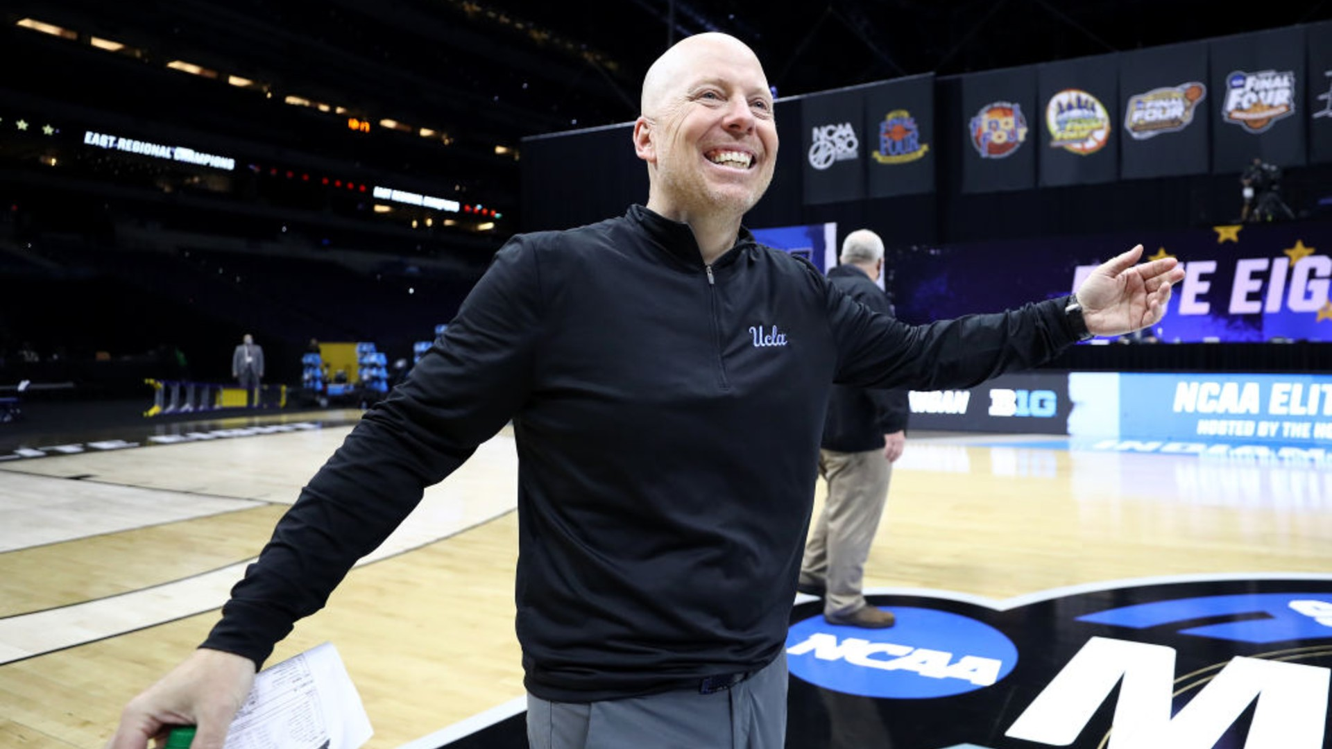 Head coach Mick Cronin of the UCLA Bruins celebrates defeating the Michigan Wolverines 51-49 in the Elite Eight round game of the 2021 NCAA Men's Basketball Tournament at Lucas Oil Stadium on March 30, 2021 in Indianapolis, Indiana. (Jamie Squire/Getty Images)