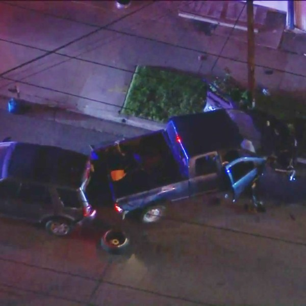 The pursuit driver's blue pickup truck is seen after crashing in Inglewood on April 28, 2021. (KTLA)
