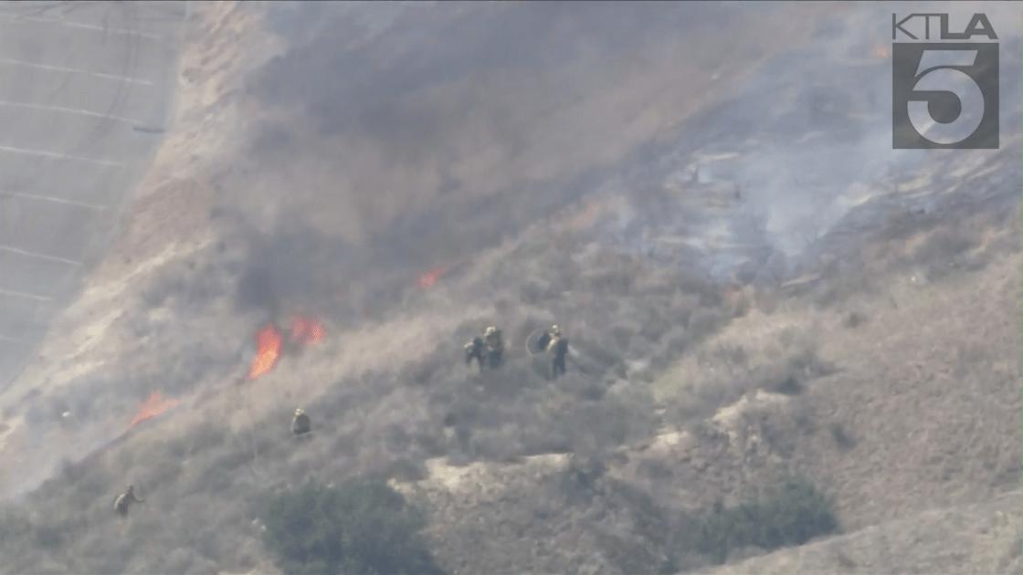 Firefighters battle a blaze in Simi Valley on April 1, 2021. (KTLA)