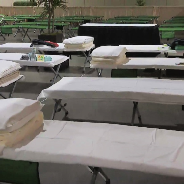 Beds for migrant children line the Long Beach Convention Center on April 22, 2021. (KTLA)