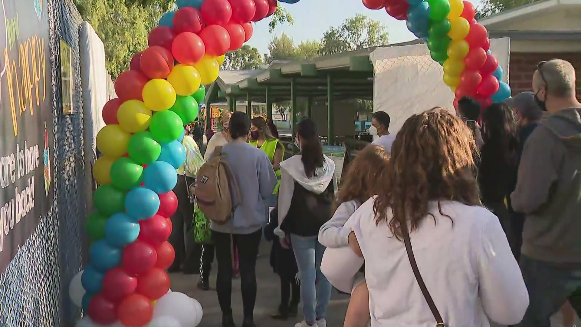 Parents and students arrive for the first day of classes at Encino Charter Elementary School on April 20, 2021. (KTLA)