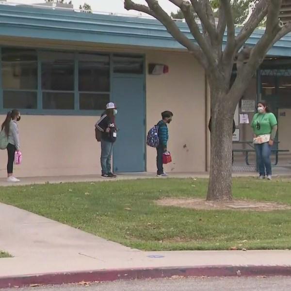 Students arrive at Jefferson Elementary School in Riverside on April 21, 2021. (KTLA)
