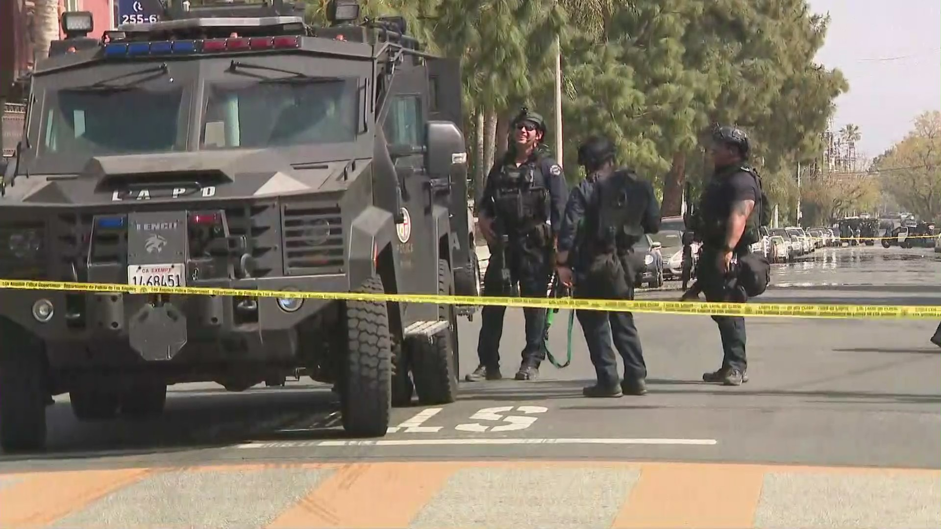 Police are seen outside a Sylmar school that had to be evacuated after reports of a man with a rifle on April 12, 2021. (KTLA)