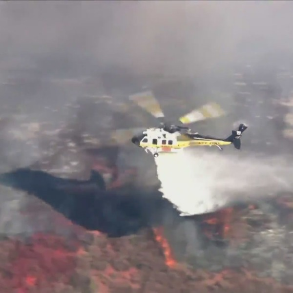 A helicopter makes a drop on the Country Fire in Thousand Oaks on April 29, 2021. (KTLA)