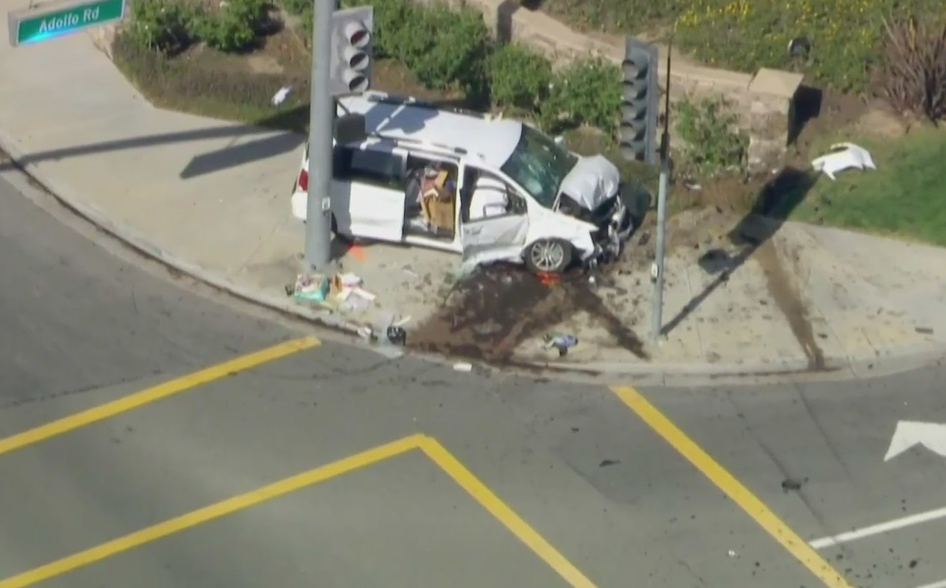 A minivan ended up on a sidewalk after a crash in Camarillo on April 16, 2021. (KTLA)
