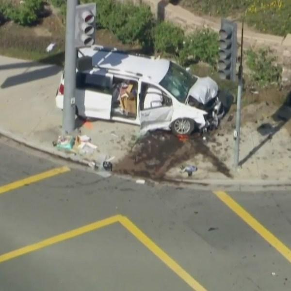 A minivan ended up on a sidewalk after a crash in Camarillo on April 16, 2021. (KTLA)