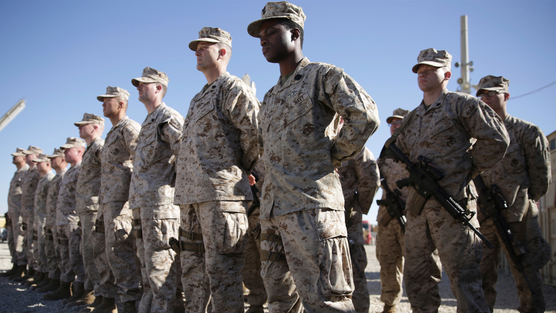 In this Jan. 15, 2018, file photo, U.S. Marines watch during the change of command ceremony at Task Force Southwest military field in Shorab military camp of Helmand province, Afghanistan. (AP Photo/Massoud Hossaini, File)