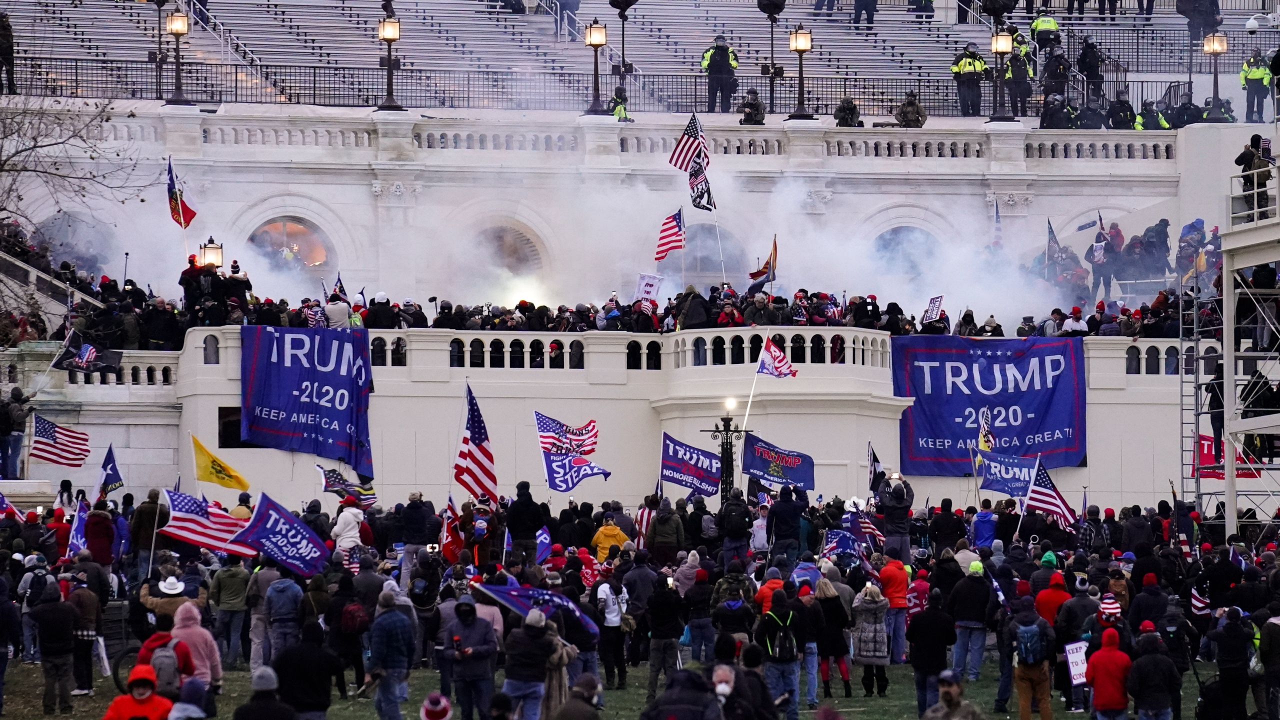 In this Jan. 6. 2021, file photo, people storm the Capitol in Washington. (AP Photo/John Minchillo)