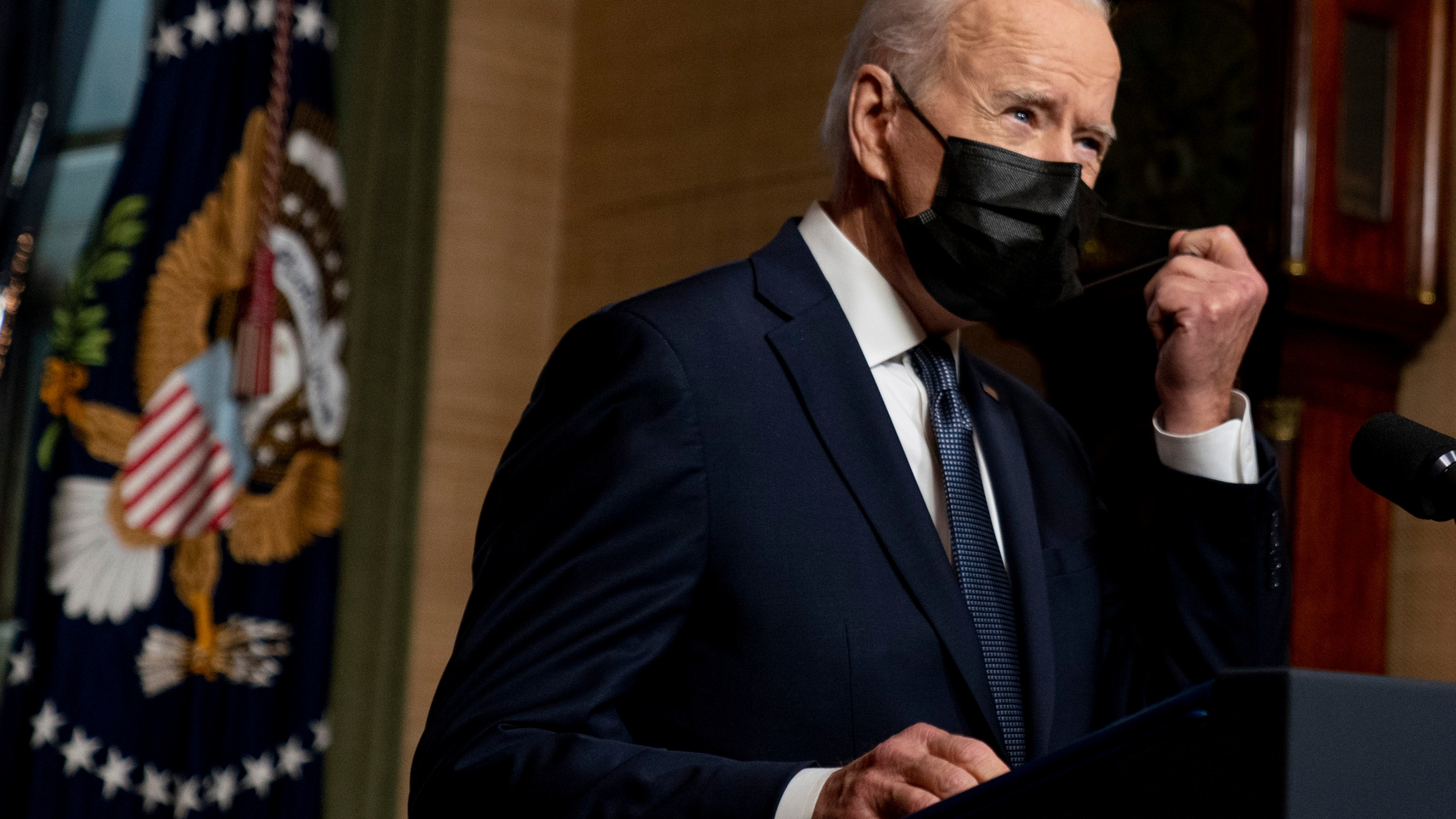 In this Wednesday, April 14, 2021, file photo, President Joe Biden removes his mask to speak at a news conference at the White House, in Washington. Ten liberal senators are urging Biden to back India and South Africa's appeal to the World Trade Organization to temporarily relax intellectual property rules so coronavirus vaccines can be manufactured by nations that are struggling to inoculate their population. (AP Photo/Andrew Harnik, Pool, File)