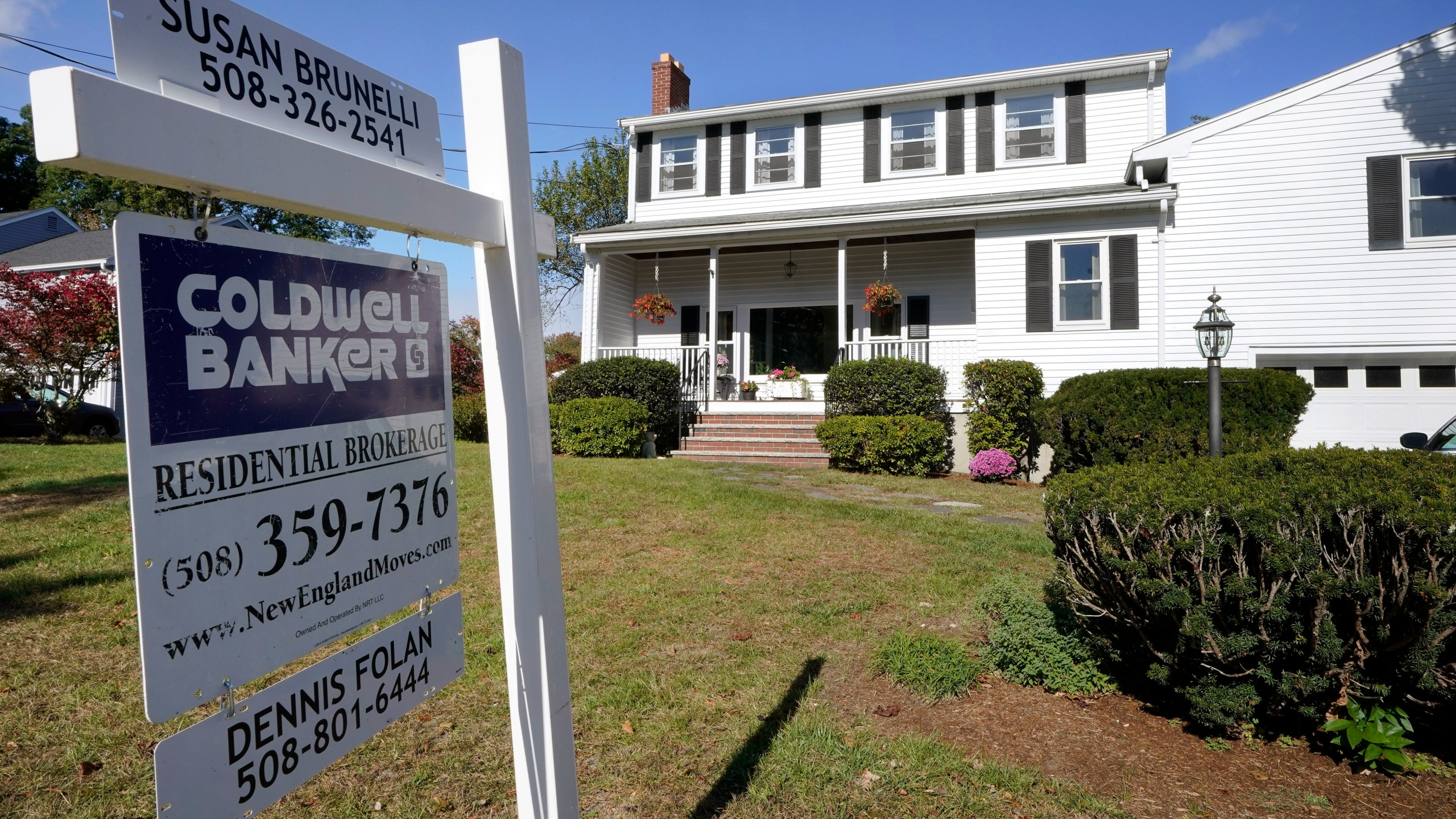 In this Oct. 6, 2020 file photo, a real estate brokerage sign stands in front of a house in Norwood, Mass. (AP Photo/Steven Senne)
