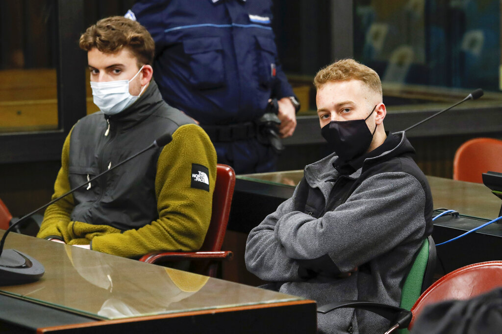In this April 29, 2021 file photo, Gabriel Natale-Hjorth, left, and his co-defendant Finnegan Lee Elder, both from the United States, wear face masks to curb the spread of COVID-19 as they sit during a break of a hearing of their trial in Rome. (Remo Casilli/Pool Photo via AP)