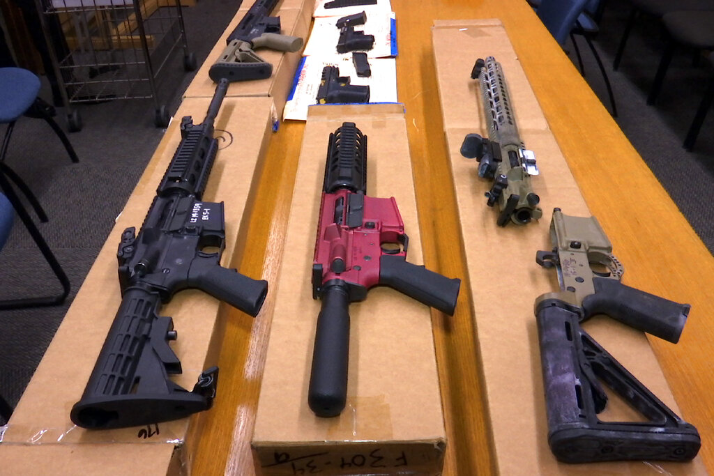"""This Nov. 27, 2019, file photo shows """"ghost guns"""" on display at the headquarters of the San Francisco Police Department in San Francisco. (AP Photo/Haven Daley, File)"""