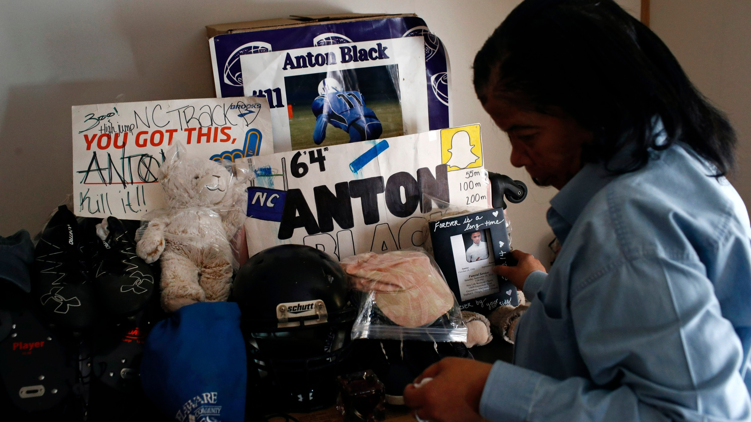 In this Jan. 28, 2019 file photo, Jennell Black, mother of Anton Black, looks at a collection of her son's belongings at her home in Greensboro, Md. Anton Black, 19, died after a struggle with three officers and a civilian outside the home in September 2018. Cases involving police use of force often include questions about the internal records of the officers involved, records that in most cases are off-limits to the press and public. Lawmakers in at least 13 states have considered bills this year to make those records more publicly available. (AP Photo/Patrick Semansky, File)