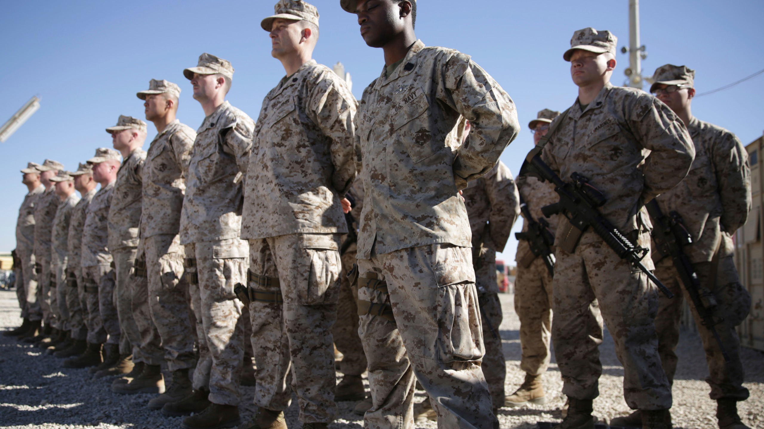 In this Jan. 15, 2018, file photo, U.S. Marines watch during the change of command ceremony at Task Force Southwest military field in Shorab military camp of Helmand province, Afghanistan.(AP Photo/Massoud Hossaini, File)