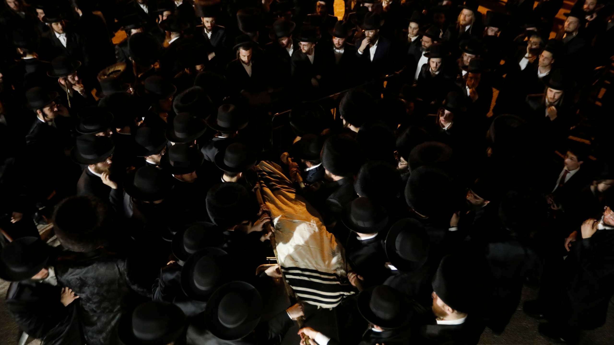 Mourners carry the body of Menachem Knoblowitz, 21, from the United States, who died during Lag BaOmer celebrations at Mt. Meron in northern Israel, at his funeral in Jerusalem on Saturday, May 1 2021. A stampede at a religious festival attended by tens of thousands of ultra-Orthodox Jews in northern Israel killed dozens of people and injured about 150 early Friday, medical officials said. It was one of the country's deadliest civilian disasters. (AP Photo/Ariel Schalit)