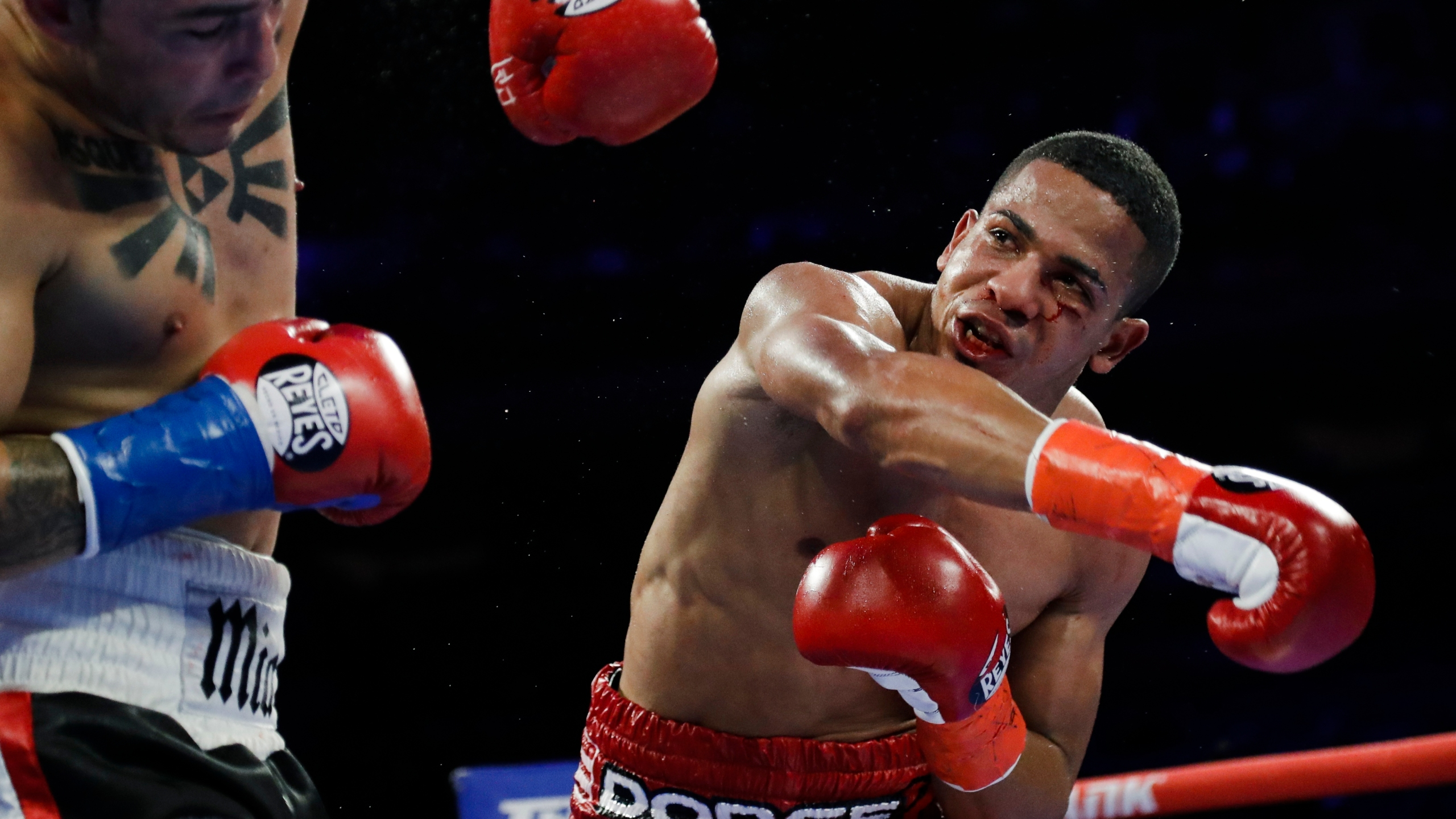In this April 20, 2019 file photo, Puerto Rico's Felix Verdejo, right, punches Costa Rica's Bryan Vazquez during the fifth round of a lightweight boxing match in New York. Verdejo has turned himself in to federal agents on Saturday, May 1, 2021, just hours after authorities identified the body of his 27-year-old lover Keishla Rodríguez in a lagoon in the U.S. territory, a couple of days after she was reported missing. (AP Photo/Frank Franklin II, File)