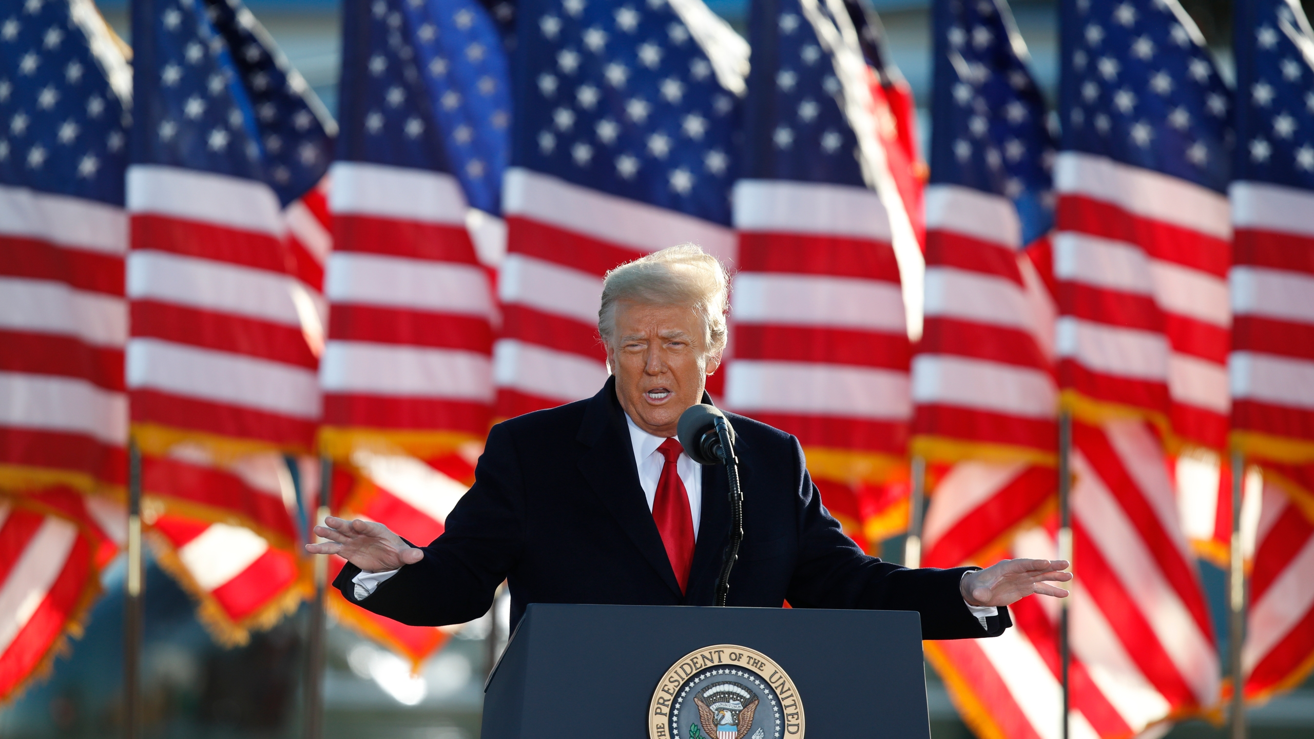 President Donald Trump speaks to crowd before boarding Air Force One at Andrews Air Force Base, Md., in this Wednesday, Jan. 20, 2021, file photo. (AP Photo/Luis M. Alvarez, File)