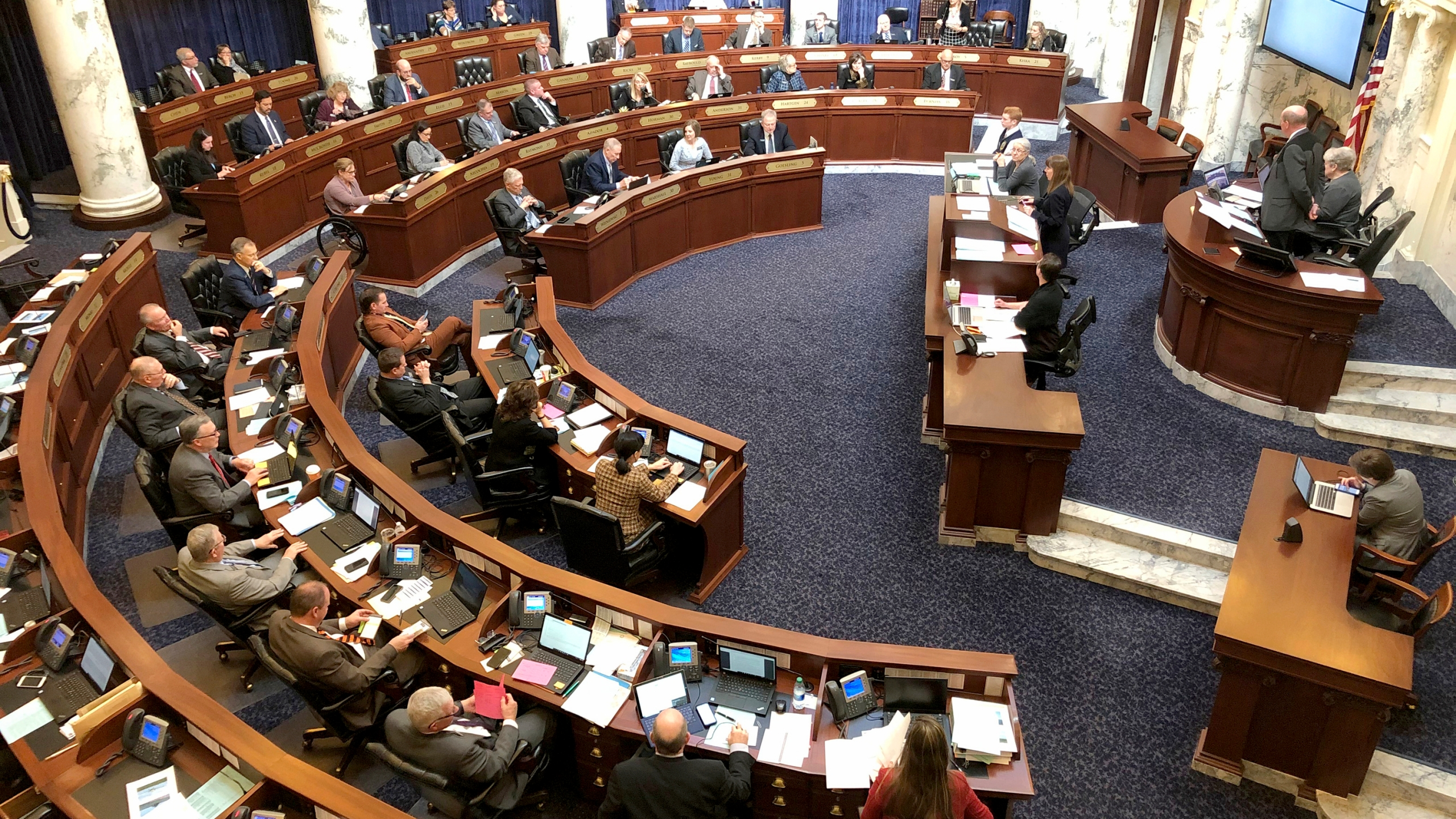 In this Feb. 27, 2020, file photo, Idaho House of Representatives debates legislation in the Idaho Statehouse in Boise, Idaho. Idaho lawmakers moved forward with legislation banning transgender people from changing the sex listed on their birth certificates despite a federal court ruling declaring such a ban unconstitutional. An appeals court on Monday, May 3, 2021, will consider the constitutionality of the first law in the nation banning transgender women and girls from playing on women's sports teams. The 9th U.S. Circuit Court of Appeals will hear arguments in the case that will likely have far-ranging consequences as more states follow conservative Idaho's lead. (AP Photo/Keith Ridler, File)