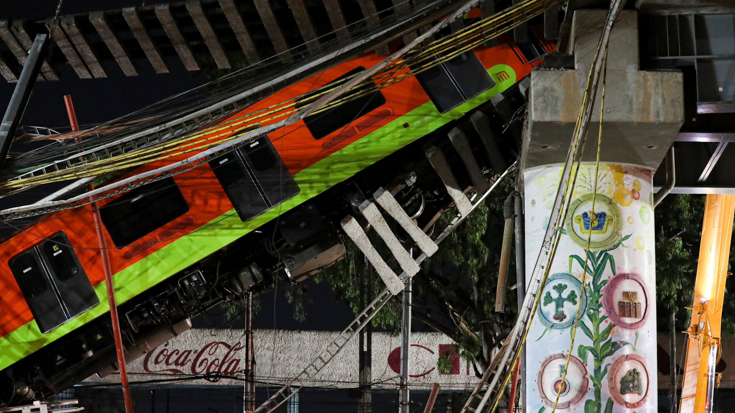 Mexico City's subway cars lay at an angle after a section of Line 12 of the subway collapsed in Mexico City on May 4, 2021. (Marco Ugarte / Associated Press)