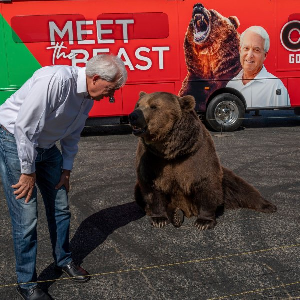 """John Cox, Republican recall candidate for California governor, begins his statewide """"Meet the Beast"""" bus tour on May 4, 2021, with Tag, a Kodiak brown bear, at Miller Regional Park in Sacramento. (Renee C. Byer / The Sacramento Bee via Associated Press)"""