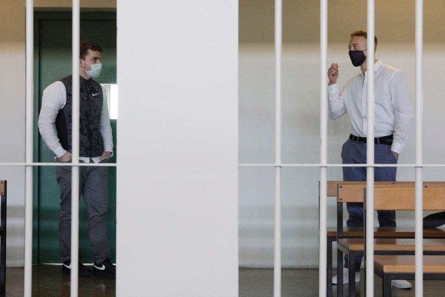 Gabriel Natale-Hjorth, right, talks to his co-defendant Finnegan Lee Elder, before a jury began deliberating their fate as they are on trial for the slaying of an Italian plainclothes police officer on a street near the hotel where they were staying while on vacation in summer 2019, in Rome, on May 5, 2021. (AP Photo/Gregorio Borgia)