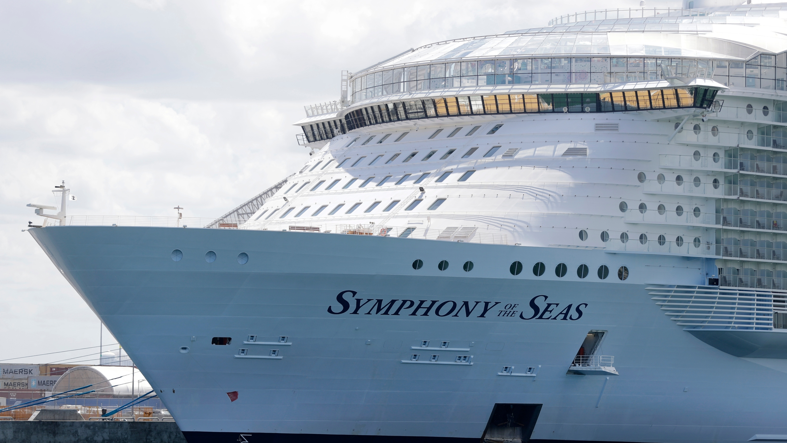 The Symphony of the Seas cruise ship is shown docked at PortMiami, in a Wednesday, May 20, 2020, file photo, in Miami. Cruise lines can soon begin trial voyages in U.S. waters. They'll have to carry some volunteer passengers, who will have to wear face masks and observe social distancing while on board. The Centers for Disease Control and Prevention gave ship operators final technical guidelines Wednesday, May 5, 2021 for the trial runs. (AP Photo/Wilfredo Lee, File)
