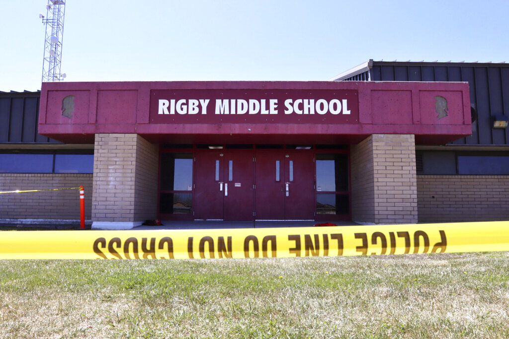 Police tape marks a line outside Rigby Middle School following a shooting there earlier Thursday, May 6, 2021, in Rigby, Idaho. (AP Photo/Natalie Behring)