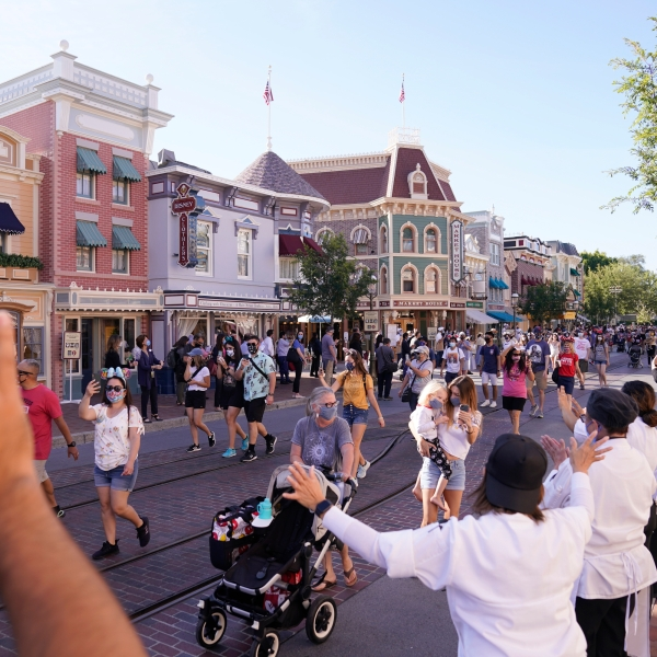 In this April 30, 2021, file photo, guests walk down Main Street USA at Disneyland in Anaheim. (AP Photo/Jae Hong, File)