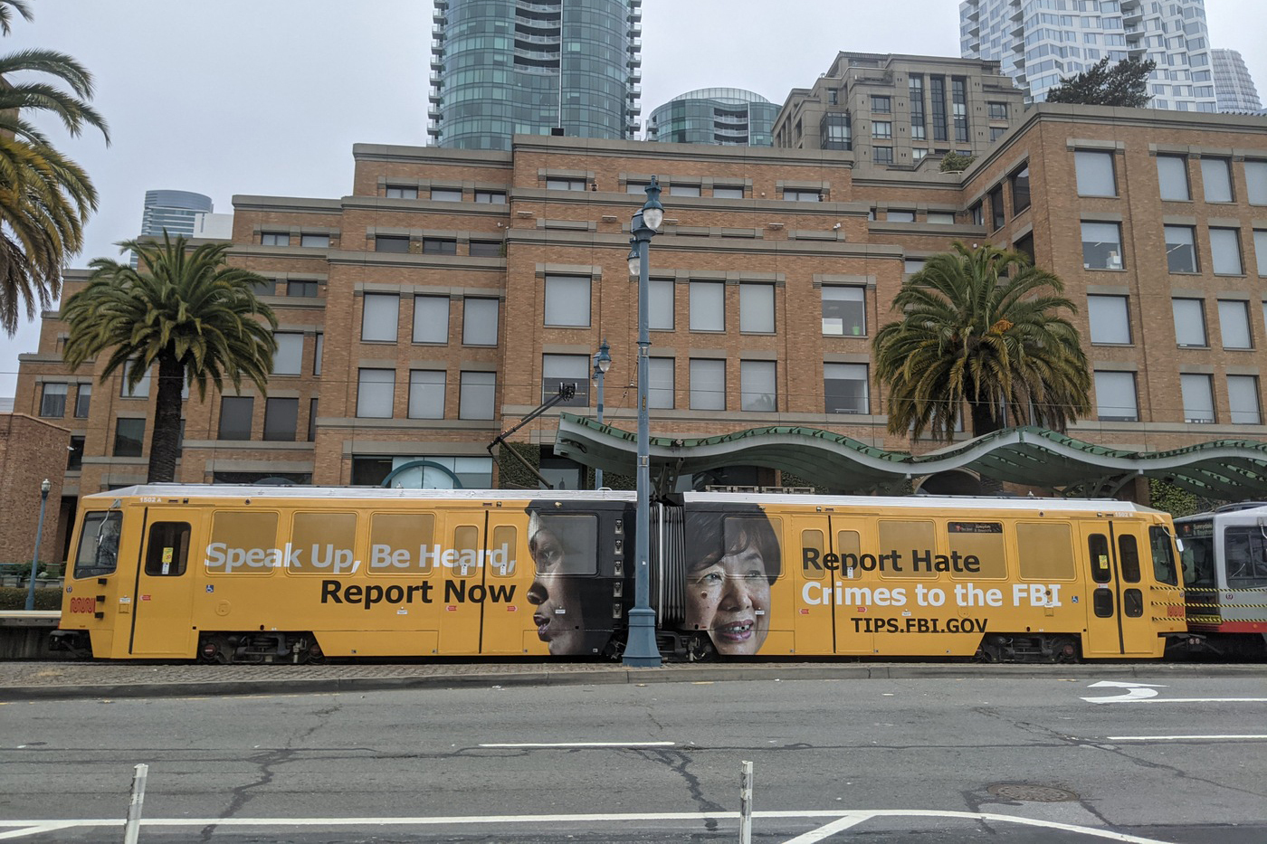 "In this image provided by the FBI, an ad on a San Francisco city train reads ""Speak Up, Be Heard, Report Now. Report Hate Crimes to the FBI."" as part of a publicity campaign by the San Francisco FBI office to encourage victims of hate crimes to come forward and report hate incidents, federal officials announced Thursday, May 6, 2021. It also launched a social media campaign that includes the photo of an elderly Asian woman and a message that reads, ""Did you know many hate crimes are not reported? The FBI wants to help but we need to hear from you."" (FBI via AP)"