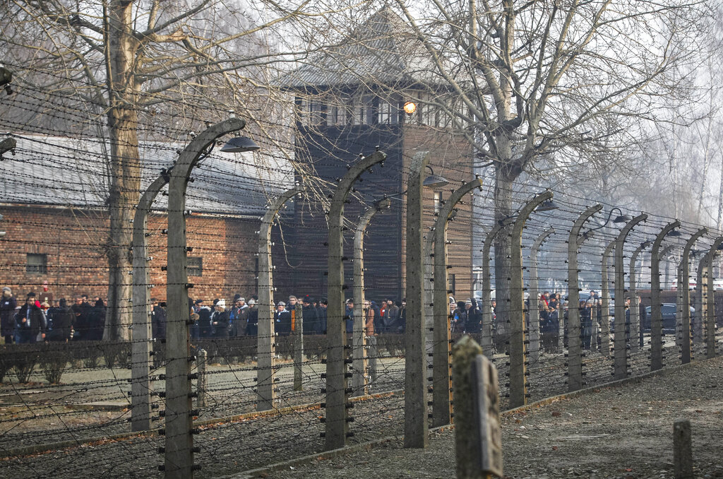 """In this file photo taken Jan. 27, 2020, people are seen arriving at the site of the Auschwitz-Birkenau Nazi German death camp, where more than 1.1 million were murdered, in Oswiecim, Poland, for observances marking 75 years since the camp's liberation by the Soviet army. Needham, Massachusetts-based TripAdvisor on Thursday, May 6, 2021, faced criticism from the camp's museum and memorial after an author posted an inappropriate review of the museum on the TripAdvisor website, stating the reviewer visited to """"test the chamber"""". The company originally declined to remove the message. (AP Photo/Czarek Sokolowski, FIle)"""