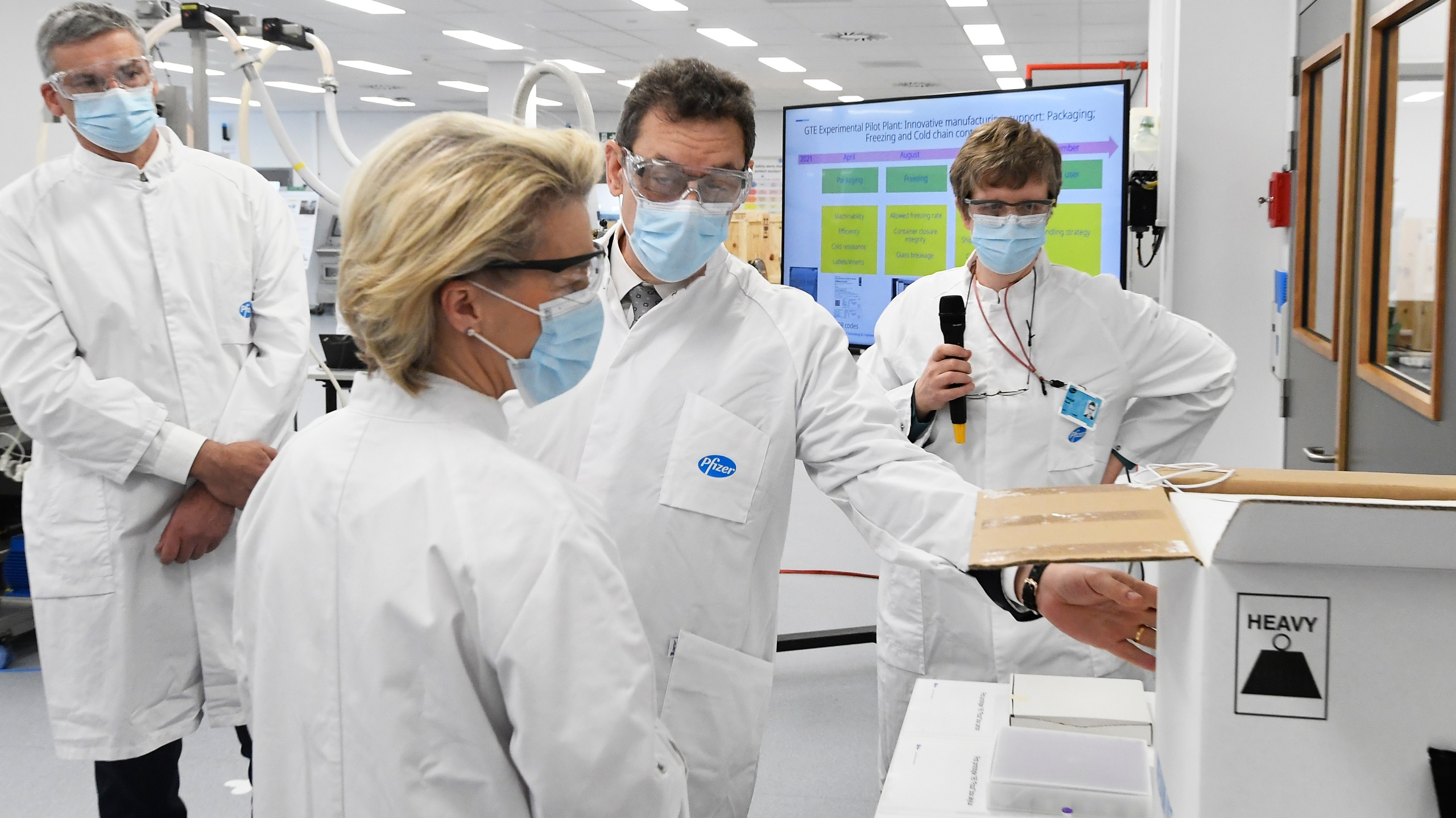 In this Friday, April 23, 2021 file photo, European Commission President Ursula von der Leyen, second left, speaks with Pfizer CEO Albert Bourla, center right, during an official visit to the Pfizer pharmaceutical company in Puurs, Belgium. (John Thys/Pool via AP, File)