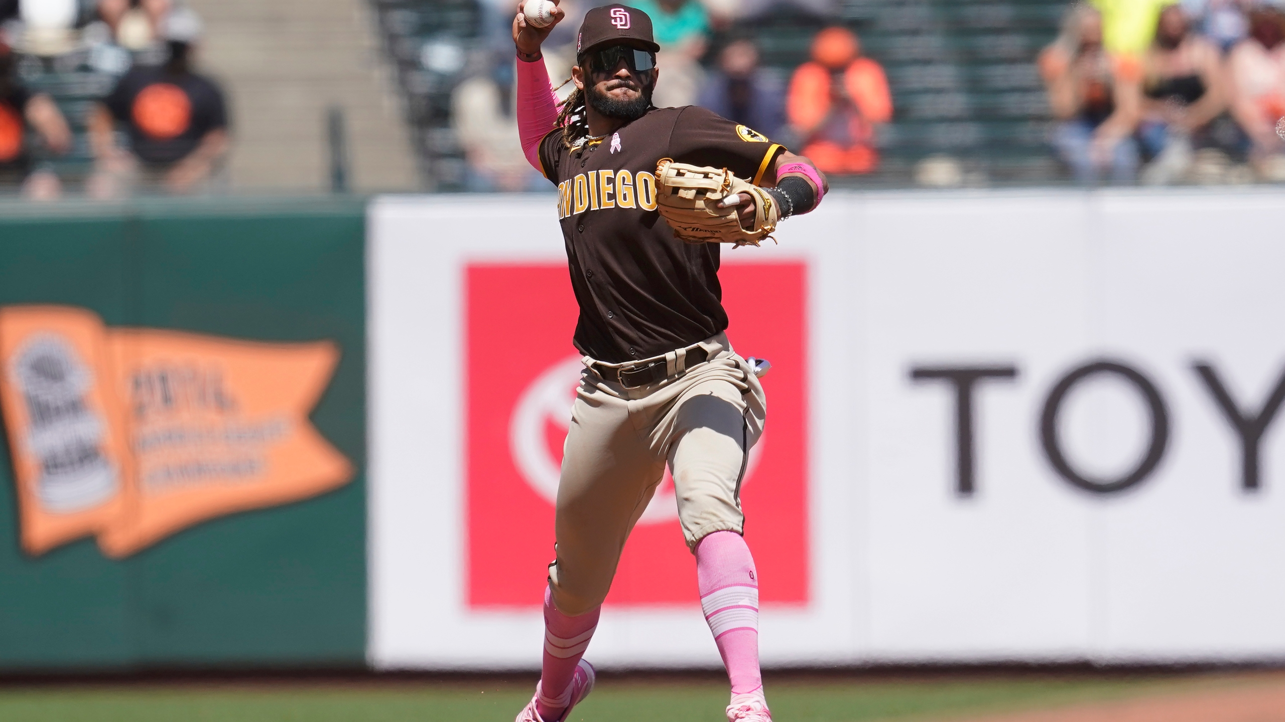 San Diego Padres shortstop Fernando Tatis Jr. throws out San Francisco Giants' Austin Slater at first base during the fifth inning of a baseball game in San Francisco on May 9, 2021. (Jeff Chiu / Associated Press)