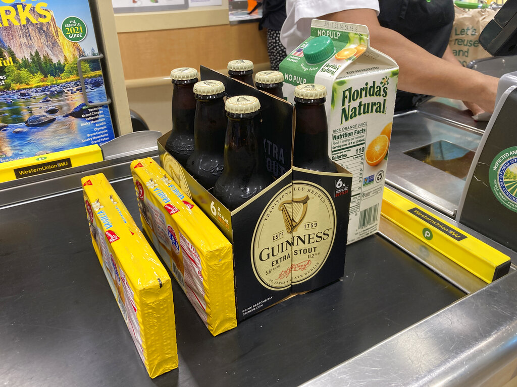 Groceries are shown at a checkout counter, Friday, April 16, 2021, at a grocery store in Surfside, Fla. (AP Photo/Wilfredo Lee)