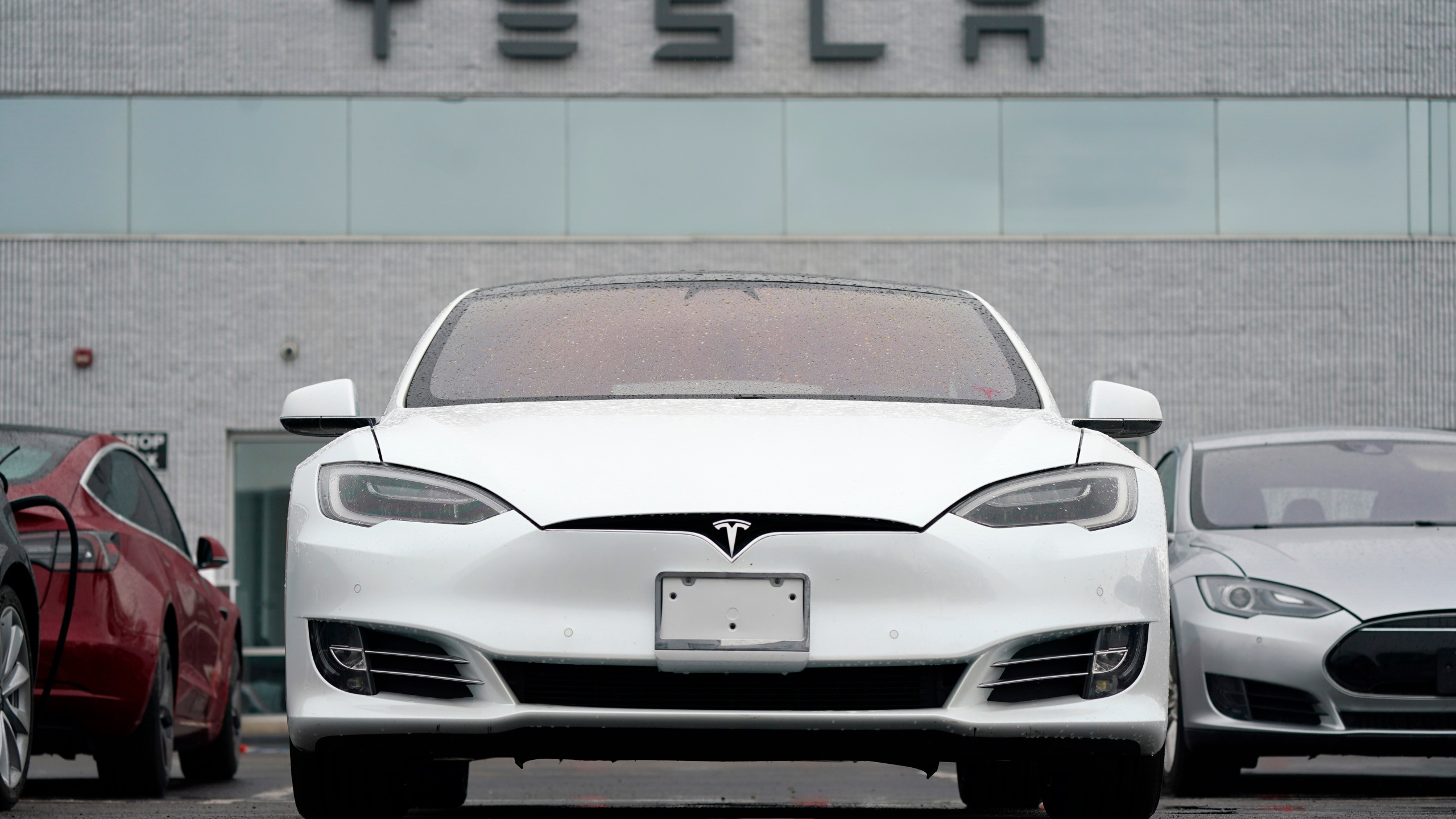 This Sunday, May 9, 2021 file photo shows vehicles at a Tesla location in Littleton, Colo. (AP Photo/David Zalubowski)