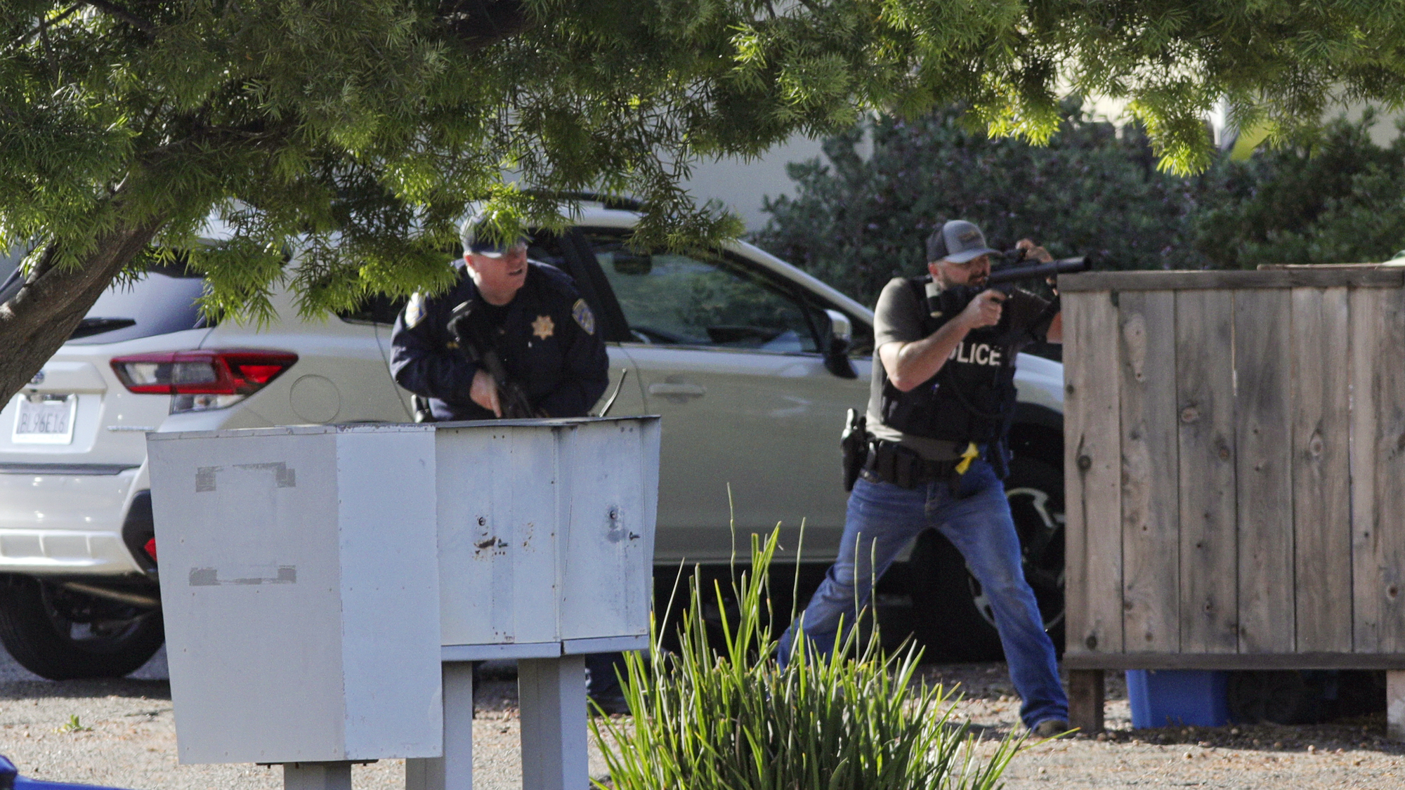 Officers take aim at an apartment across Camilla Court on May 10, 2021, in San Luis Obispo, Calif. (David Middlecamp/The Tribune of San Luis Obispo via AP)
