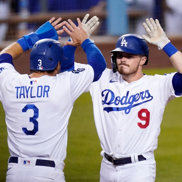 Los Angeles Dodgers' Gavin Lux, right, is congratulated by Chris Taylor after hitting a three-run home run during the eighth inning of an interleague baseball game against the Seattle Mariners on May 11, 2021, in Los Angeles. (AP Photo/Mark J. Terrill)