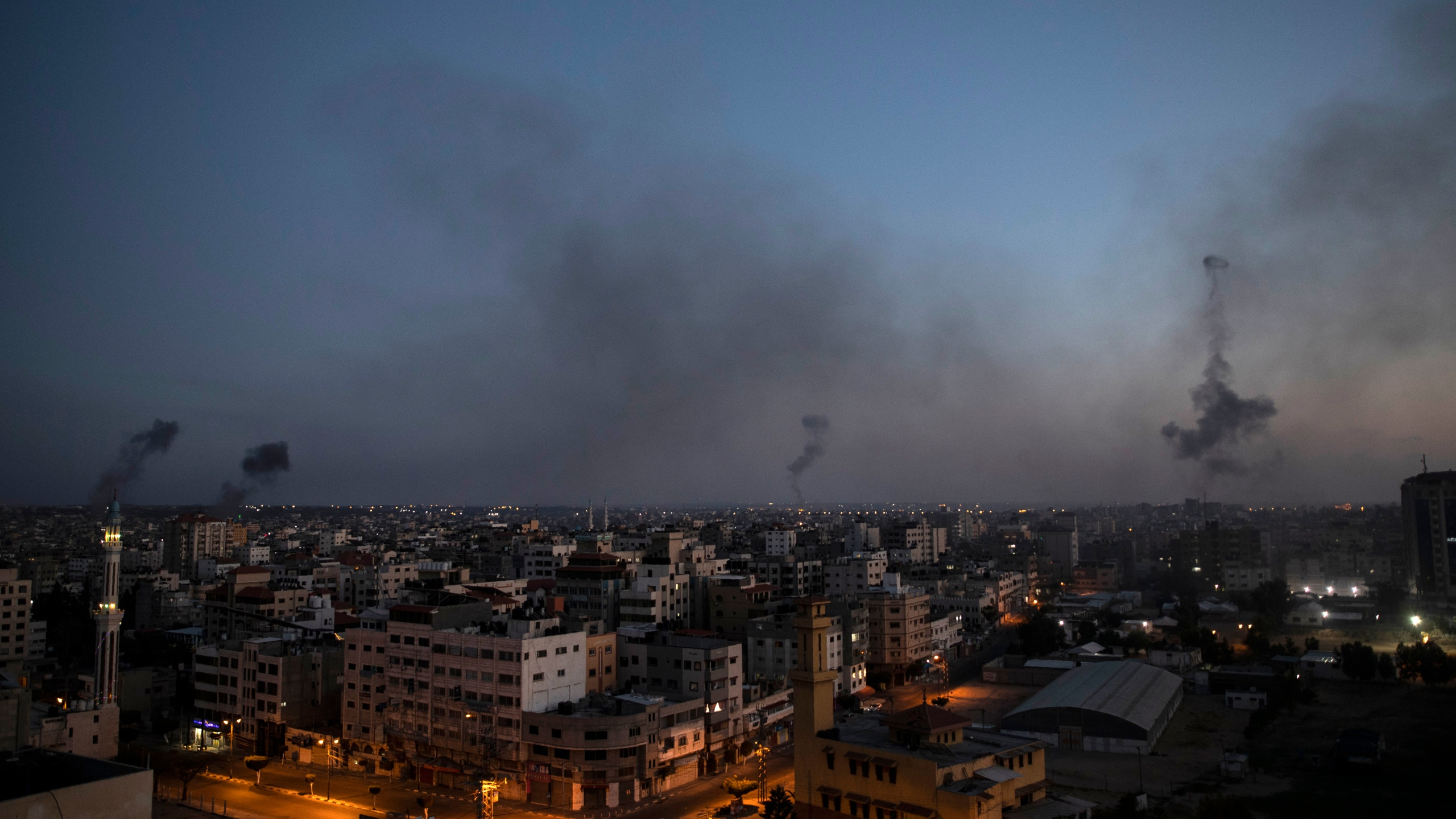 Black smoke rise following Israeli airstrikes on Gaza City, Wednesday, May 12, 2021. (AP Photo/Khalil Hamra)