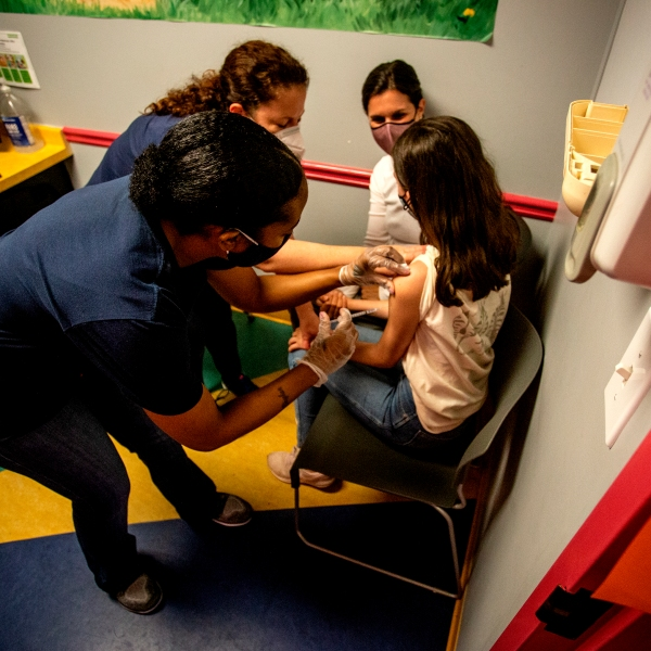 Middle school student Elise Robinson receives her first coronavirus vaccination on May 12, 2021 in Decatur, Ga. (Ron Harris/Associated Press)