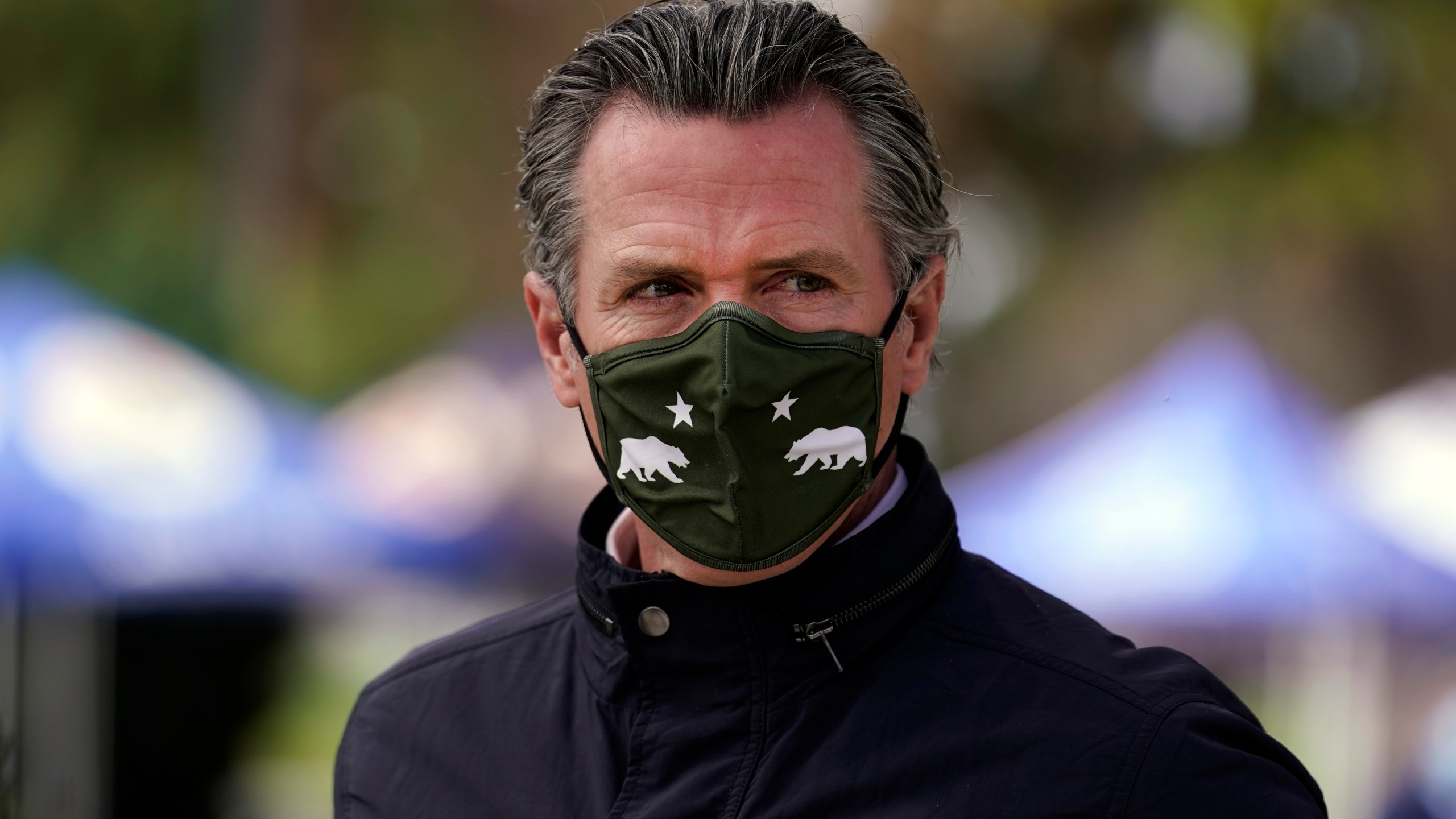 In this March 10, 2021, file photo, California Gov. Gavin Newsom wears a mask during a visit to a vaccination center in South Gate, Calif. (AP Photo/Marcio Jose Sanchez, File)
