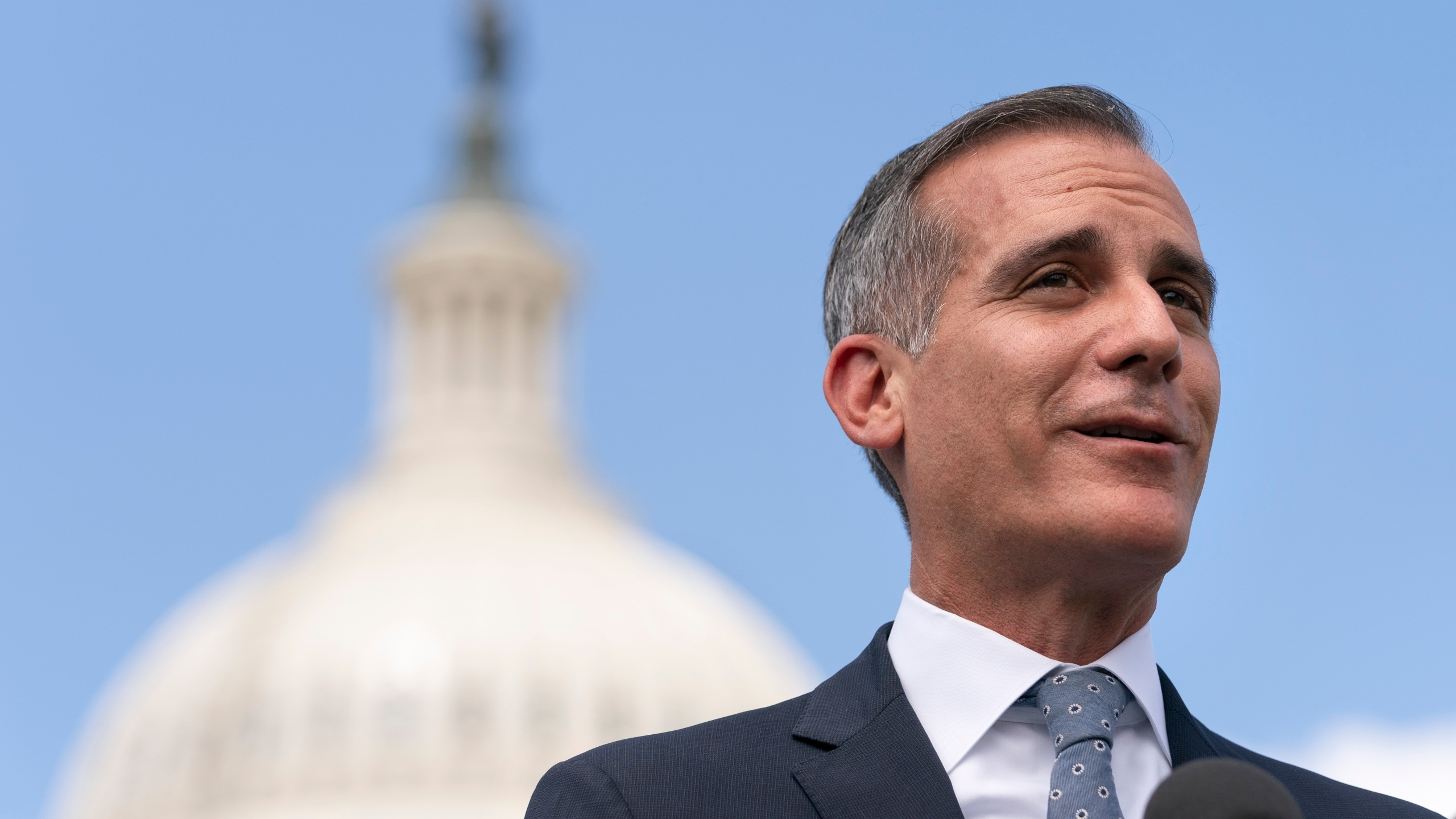 Los Angeles Mayor Eric Garcetti speaks during a news conference with House Transportation and Infrastructure Committee Chair Peter DeFazio on Capitol Hill in Washington on May 12, 2021. (Jacquelyn Martin / Associated Press)